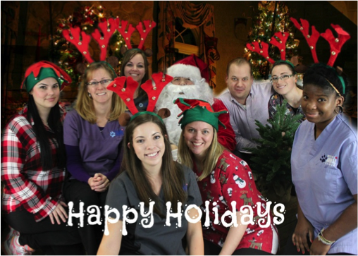 West Hill Animal Clinic staff with Happy Holidays text